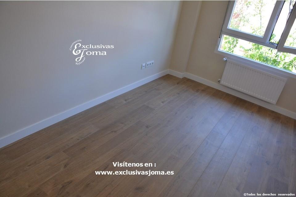 Reforma integral de piso en Tres Cantos en avenida Viñuelas,decoracion y diseño interior,tarima flotante Quick Step,puertas lacadas, ventans en pvc rpt,venacal (16)